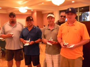 """The 2013 winning team of the """"Safety First"""" Steve Saggiani Memorial Golf Tournament accepts their trophies: (L-R) Pete Cucuk, Mike Ponce, Steve Pekich, and Michael Clapp"""